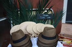 Party favors Cuban style hats for men and fans for women