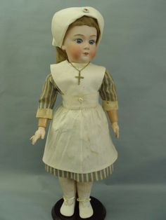 Marked: 8192 Germany Gebrüder Heubach sunburst mark GH. This adorable doll was made some time 1911-1914 dressed in authentic WW1 nurse costume, her mohair wig, dress and silk petticoat original to this doll. | eBay!