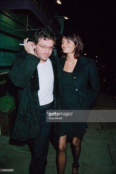 Australian singer and songwriter Michael Hutchence (1960 - 1997) and Danish fashion model Helena Christensen leaving the San Lorenzo restaurant, London, 22nd February 1995.