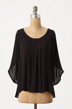 I love the soft pleats and interesting sleeves.