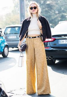 Stay on trend this season with wide leg mustard coloured trousers | Image via whowhatwear.com