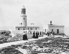 People Strolling Around the Lighthouse GroundsRound Island, Isles Of Scilly, circa 1910 - Past Pix/SSPL via Getty Images