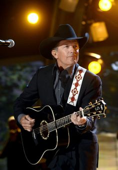 George Strait. Love his guitar! I would love to sit down, write and record a song with him :)