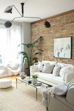 Exposed brick = dream apartment status: Read More on SMP: http://www.stylemepretty.com/living/2016/06/07/why-decorating-with-neutrals-will-never-ever-go-out-of-style/