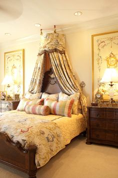 I love the way that this bed canopy really ties in the artwork and coordinating fabrics on the bed!