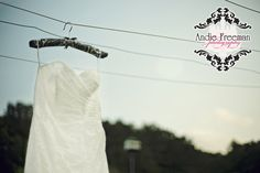Strapless wedding gown hanging from clothesline. Summer shabby chic barn wedding. Photography by Andie Freeman Photography www.TheAthensWeddingPhotographer.com Event design, floral, and planning by Wildflower Event Services www.WildflowerEventServices.com Venue:  Private property in Chickamauga, Ga Barn Wedding Inspiration, Event Services, Private Property, Event Design, Wedding Details, Summer Wedding, Wild Flowers, Real Weddings, Wedding Gowns
