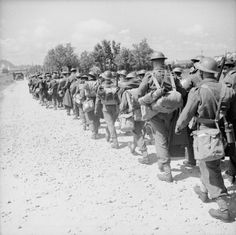 The Evacuation of the BEF from France, June 1940: A column of British soldiers retreating to the Channel ports.