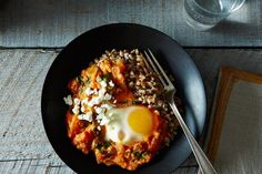 Shakshuka with Grains and Feta on Food52  Great! Add more greens, season sauce well (& add 'chovies). Make in deep skillet, not Le Creuset pot. Maybe finish (eggs) in oven so whites get cooked but yolks are still runny.
