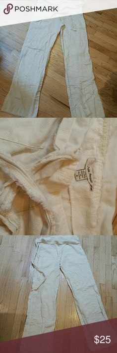 Off white pants Very soft, fairly thin nice cream colored boho pants l.100% cotton. Front pockets, attached belt, side zipper closure. Fringed hems. Free People Pants Trousers