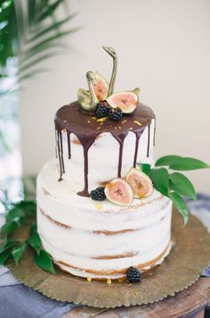 Chocolate drip wedding cake with figs