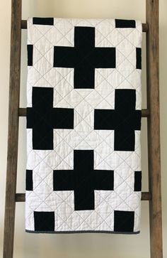 Craftyblossom: black and white cross quilt.