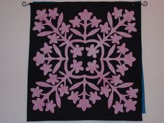 """quilt_rainbow.jpg (768×576) Annette Mahon In Above the Rainbow, the quilt shop owner makes a quilt called """"In the Black at the Pink Plumeria."""" After several quilt friends asked if I'd made the quilt described, I decided I should. This is the result, and this quilt was used as the basis for the cover design of St. Rose Goes Hawaiian."""