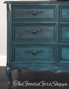 """""""This piece was finished completely with General Finishes products and I couldn't be more thrilled with the results! The dresser was painted using a custom blend of Milk Paints in Patina Green, Emerald, Coastal Blue and Corinth Blue, which created a wonderful peacock blue. The entire body was then glazed using Glaze Effects in Pitch Black. The coordinating mirror received the same paint and glaze treatment. The top of the dresser was stripped and stained using Java Gel Stain. Everything ..."""