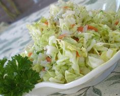 COPYcat - KFC Coleslaw -- 8 cups finely diced cabbage (about 1 head)  ¼ cup diced carrot  2 tablespoons minced onions  1⁄3; cup granulated sugar  ½ teaspoon salt  1⁄8; teaspoon pepper  ¼ cup milk  ½ cup mayonnaise  ¼ cup buttermilk  1 ½ tablespoons white vinegar  2 ½ tablespoons lemon juice