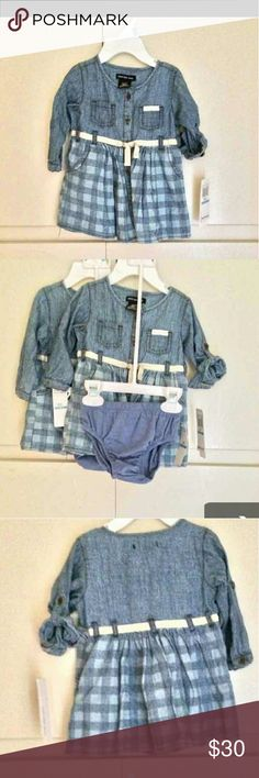 NWT Calvin Klein Kids Outfit New with tags and in perfect condition. Calvin Klein Infant size 6-9 months 2 piece set with a chambray light denim dress and matching underwear. The dress has long sleeves, two breast pockets, a cream waist belt through the belt loops (matching the accent on one of the pockets), checkered flannel plaid skirt, and one of the sleeves has a sleeve loop to fasten it to 3/4. I have two of these in the same size. The listed price is for one of these but if you want…