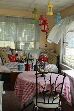 a spoonful of....: Simple Sunday on the Sun Porch  -  love the black daybed with a quilt and tons of pillows