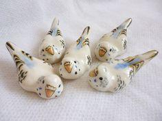 Ceramic parakeets