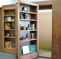 HIDDEN BOOKCASE DOOR Yes It Might Be Thousands Of Dollars To Install But Do You Know How AWESOME A Secret Door Would Have