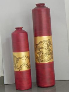 "Set of 2 pots Madhubani  style Black line work on golden & brown back ground Size: Large pot – 26"" tall x 6"" Medium pot – 19"" tall x 5"""