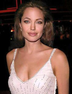 Sexy Angelina Jolie in white gown with plunging neckline. #celebrity #angelinajolie #redcarpet #fabfashionfix
