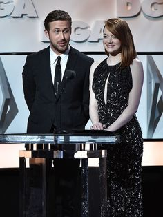 Ryan Gosling Photos Photos - Actor Ryan Gosling (L) and actress Emma Stone onstage during the 69th Annual Directors Guild of America Awards at The Beverly Hilton Hotel on February 4, 2017 in Beverly Hills, California. - 69th Annual Directors Guild of America Awards - Show