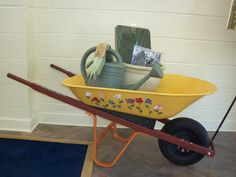 Auction Art! Kindergartners painted the flowers on this wheelbarrow and we filled with garden items for a silent auction!