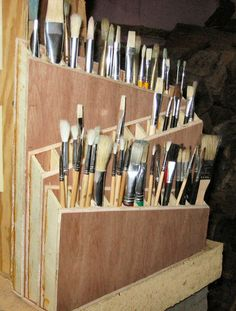 DIY paint brush holder. Looks pretty simple, I wouldn't have all three tiers on an angle.