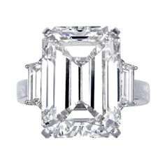 Emerald Cut Diamond Three Stone Ring | From a unique collection of vintage three-stone rings at http://www.1stdibs.com/jewelry/rings/three-stone-rings/
