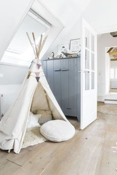 converted attic / playroom / kid's teepee More