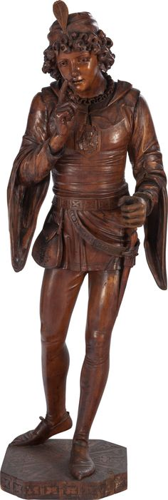 A LARGE VENETIAN CARVED FRUITWOOD FIGURE OF A RENAISSANCE PAGE BOY,circa 1850.
