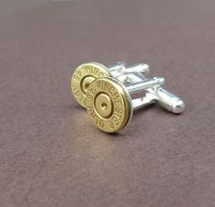 45 caliber automatic Winchester bullet cuff links gift for him groomsmen gift cufflinks. $20.00, via Etsy.