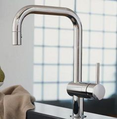 "1. Grohe Minta [top photo]  ""An amazing faucet."" Priced, well, clean, minimalistic, functional, and a great price point at about $300-400. [Pull-down, switches from flow to spray with locking button, stainless steel braid, variable handle, 3 finishes.]"