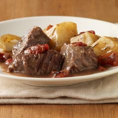 Rosemary Pot Roast : No need to worry about making gravy for this pot roast --- flavored tomatoes cook down with cream of mushroom soup while the beef slow cooks, making a delicious gravy for the meat and potatoes