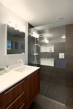 tile floor and shower makes space look bigger.