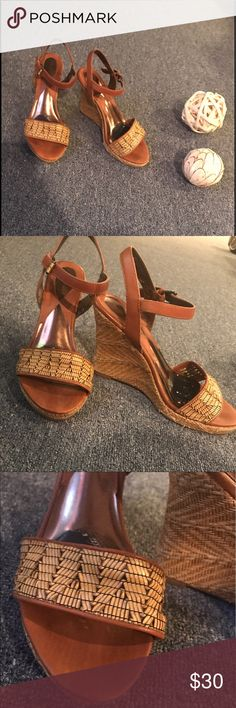TAN LEATHER STRAPPY WEDGE SANDALS W/ STRAW DETAIL The essential summer shoe!  Tan leather strappy wedge sandals, size 8.5!  Heel is about 4 inches high.  Very comfy to walk in. The straw detailing on the front of the sandals and on the heels is a fun touch. Like new condition, no wear on the bottoms of the shoes.  Brand is Ciao Bella. Ciao Bella Shoes Heels