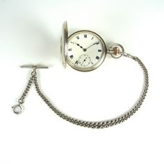 An English silver half hunter pocket watch and chain. An English silver half hunter pocket watch and chain. The 50 mm Dennison case with hinged front cover featuring viewing window with Roman numerals and one minute track covering a white enamel dial with Roman numerals, blued hour and minute hands, subsidiary seconds dial at 6 o' clock and outer one minute track. Stem wind stem set movement with crown at 3 o' clock. Case marked Birmingham 1911 and engraved to the reverse with the words, ...