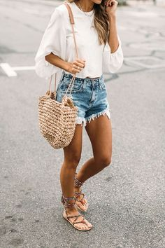 White top, denim shorts, straw bag, lace up sandals.