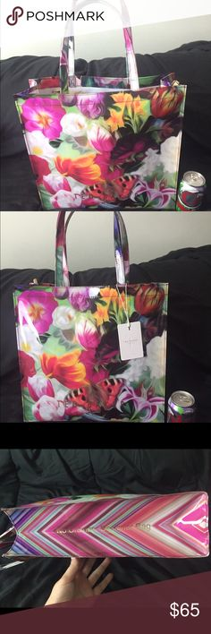 "NWT Ted Baker Floral Swirl Large Icon Bag This Ted Baker bag is a durable, high quality shopper. A springtime garden in full bloom with a butterfly colors this liquid-shine patent tote topped with over-the-shoulder handles.  All text on bag is gold: ""Ted Baker London"" on front and back. On sides: list of boutique locations and ""No ordinary designer bag""  Cleanable white interior with zippered pocket  Open top tote  Retails for $69  14.5"" x 14.5"" x 4""  8"" drop  Must be returned June 30th! Ted…"