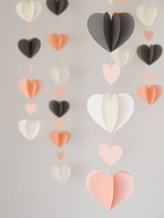 These twirly heart garlands make for a perfectly playful decor piece for your Galentine's Day brunch. Idées déco Saint Valentin DIY - Decoration ideas for Valentines Day Crush On These DIY Hearts (Handmade Charlotte) Ah, February, it's the season of l Saint Valentin Diy, Paper Heart Garland, Paper Garlands, Paper Backdrop, Diy And Crafts, Crafts For Kids, Handmade Crafts, Diy Paper Crafts, Diys With Paper