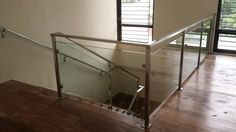 Glass Railing in Stainless Steel Frame at Better Living, Paranaque Philippines By: Cavitetrail Enterprise - Wrought Iron Railing supplier in the Philippines