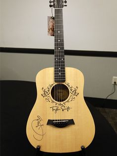 Taylor Swift signed guitar (charity auction)