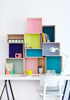 Cool storage using boxes and wallpaper to make a feature