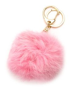 "Add a little whimsy with an oversized soft, hued rabbit fur pom and metallic accent. The perfect accessory to clip on your handbag, or use as a trendy keychain. 7"" Length (approximately) 4"" Pom Diamet"