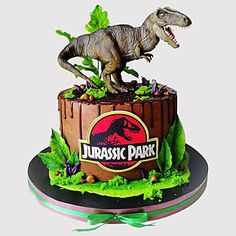 Order Jurassic Park Designer Chocolate Cake online for delivery in uae. Send Jurassic Park Designer Chocolate Cake to your loved ones with Ferns N Petals. Dinosaur Cakes For Boys, Dinosaur Birthday Cakes, 3rd Birthday Cakes, Dinosaur Dinosaur, Jurassic Park Party, Jurassic World Cake, Jurrasic Park Cake, Bolo Dino, Dinasour Birthday