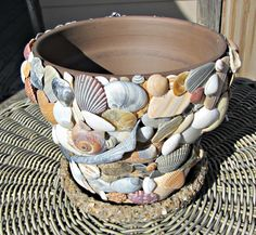 Beautiful brown terracotta planter with shells collected from the beach in Nags Head NC (Outer Banks) All shells are natural and in their natural state.