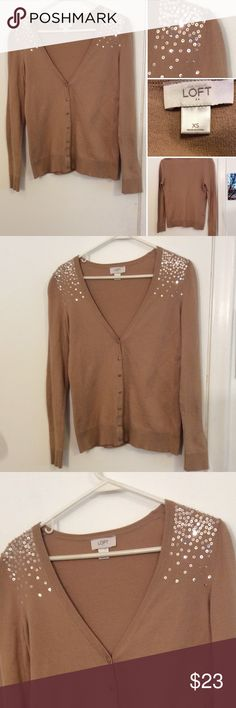 Ann Taylor LOFT Cardigan This Ann Taylor LOFT cardigan is in excellent condition. It's a Carmel color with embellished shoulders. It is a button down size XS polyester blend LOFT Sweaters Cardigans