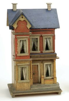 """ca. 1895 no. 2444. All original details, except for the loss of a small figural medallion from the projecting gable. Original red and white brick papers, painted trim with red accents, deep blue roof with white chimneys. The balcony is painted blue and trimmed with Dresden paper. Original wallpapers and borders, as well as floor papers and patterned cotton draperies  21.5"""" t, 12"""" w, 10"""" d."""