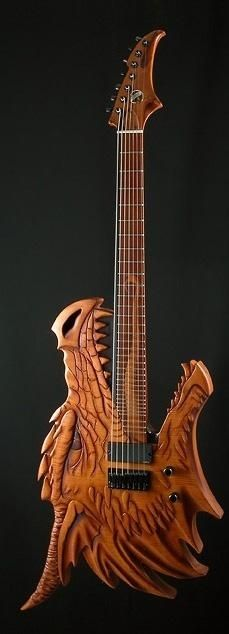 Wood body Carved dragon guitar. Notice the unusual design of having seven strings.