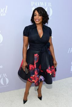 Niecey Nash beamed at The Hollywood Reporter 24th Annual Women in Entertainment Breakfast in a floral print dress.