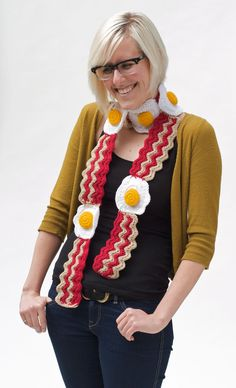 Get voted Best Dressed at your Breakfast Club! Our savory Bacon & Egg scarf is hand-crocheted and perfect for peeps who love to have fun with their accessories. You get a healthy serving of tasty, wiggle-wavy bacon strips and a stack of fried eggs with 3D sunshine yellow yolks. Both guys and girls have rocked this morsel, and it's always a great conversation starter!